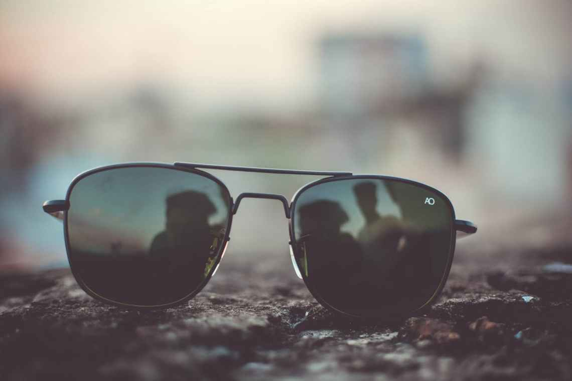focus photo of black aviator style sunglasses on surface